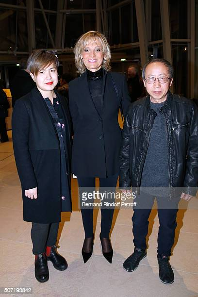 "Artist Cao Fei, Helene Arnault and Artist Huang Yong Ping attend the ""Bentu"" Exhibition at the Louis Vuitton Foundation, Co-organized with the..."