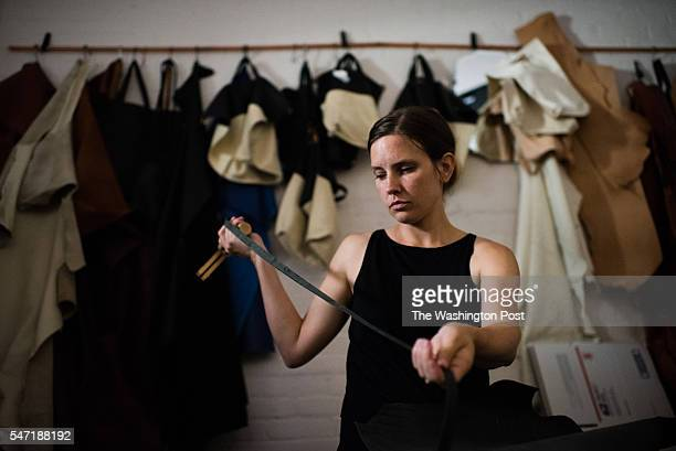 Artist Carolyn Misterek works in her studio in the Brewmaster Studios which is the carriage house behind the mansion She is cutting straps for MATINE...