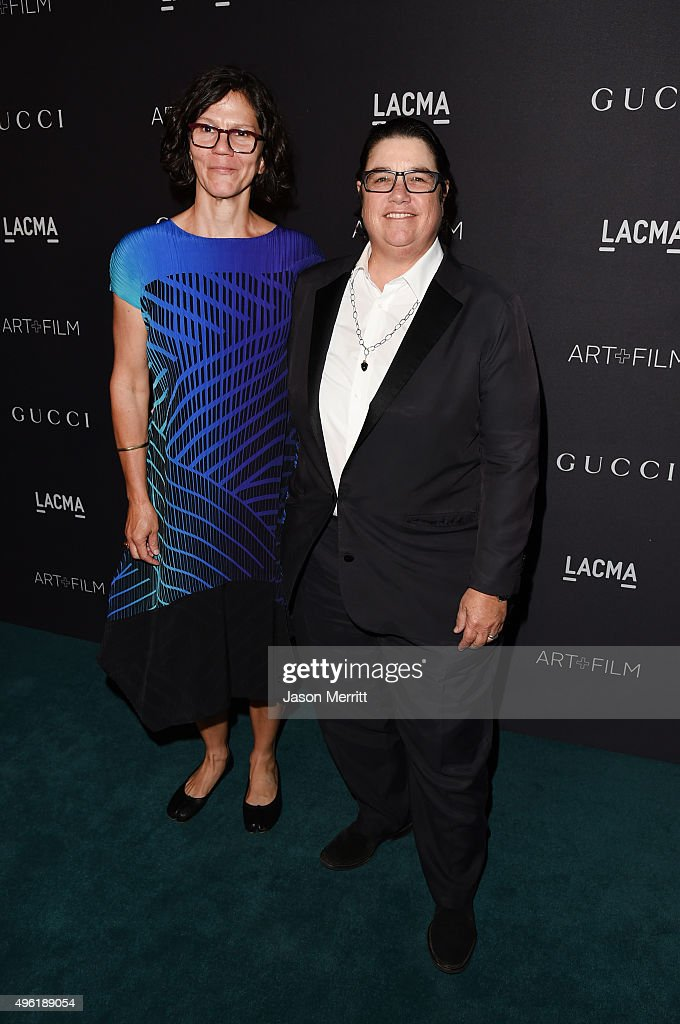 Artist Catherine Opie (R) and Julie Burleigh attend LACMA 2015 Art+Film Gala Honoring James Turrell and Alejandro G Iñárritu, Presented by Gucci at LACMA on November 7, 2015 in Los Angeles, California.