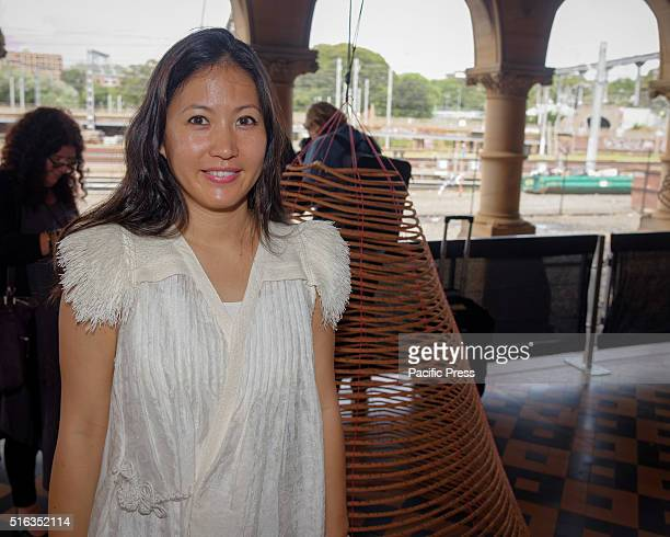 ISLAND SYDNEY NSW AUSTRALIA Artist Charwei Tsai poses with 'Spiral Incense Mantra' at the Mortuary Station The Embassy of Transition during the media...