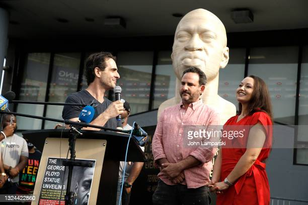 Artist Chris Carnabuchi, Chris Cohen and Lindsay Eshelman of Confront Art speak during the unveiling of George Floyd statue as New York City Honors...