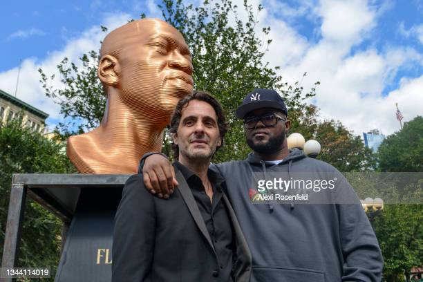 """Artist Chris Carnabuci and Terrence Floyd stand in front of the """"Floyd"""" sculpture during Confront Art's First Exhibition launch SEEINJUSTICEin Union..."""