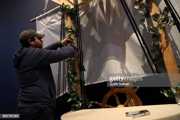 """Artist Chris Treggiari works on his """"Ghost Ship"""" art installation at the Oakland Museum of California on September 21, 2017 in Oakland, California...."""