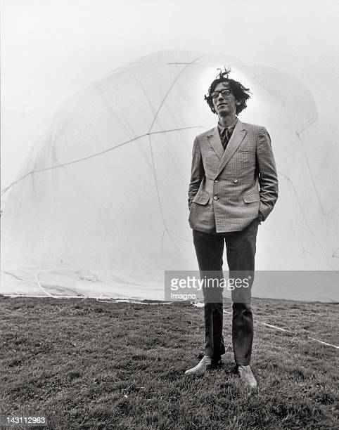 Artist Christo at the documenta IV in Kassel Germany In the background his work 5450 m cubic package Photograph 1968