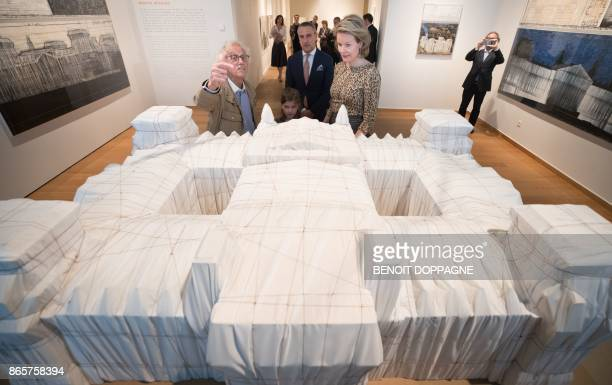 Artist Christo talks to Queen Mathilde of Belgium by a model of the 1995 project Wrapped Reichstag during a visit of the exhibition Christo and...