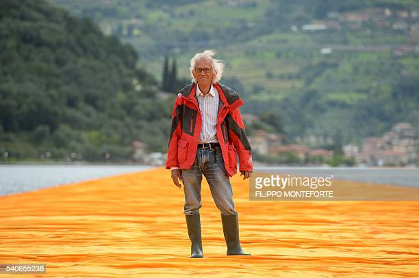Artist Christo Vladimirov Javacheff walks on his monumental installation The Floating Piers he created with late JeanneClaude on June 16 2016 during...