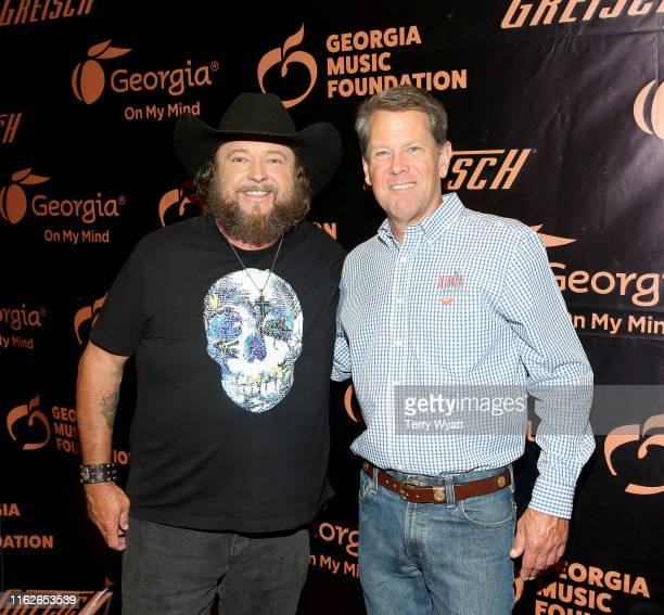 Artist Colt Ford and Georgia governor Brian Kemp take photos backstage during the 6th Annual Georgia On My Mind presented by Gretsch at Ryman...