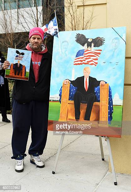 Artist Corey O'Neal poses with one of his paintings at Donald Trump's Inauguration ceremony on January 20 2017 in Washington DC