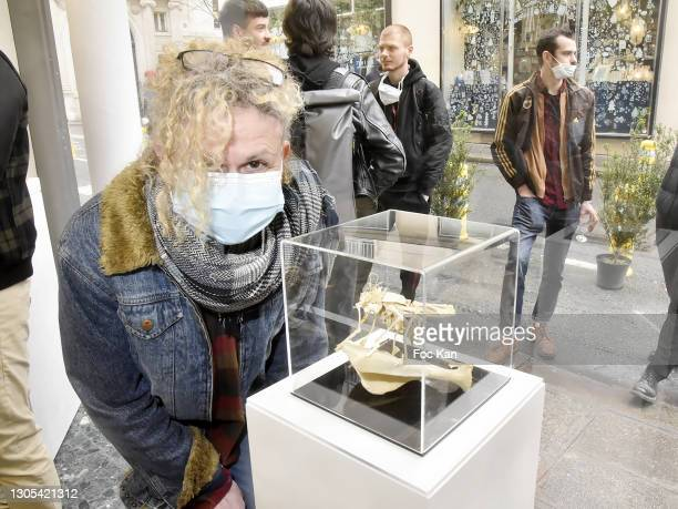 """Artist Corine Borgnet poses with her bones sculpture during """"Ils Ont Dit Oui"""" Exhibition an Amalteo Institute Project Curated by Marc Molk at Galerie..."""