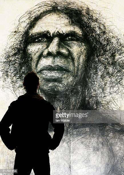 Artist Craig Ruddy stands before his Archibald Prize winning portrait of Australian Aboriginal actor David Gulpilil during a viewing of some...