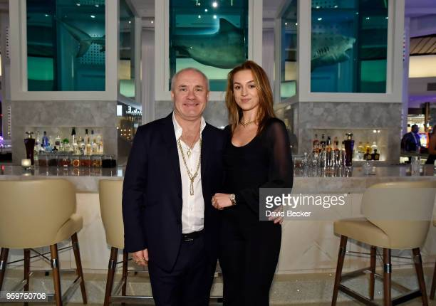 Artist Damien Hirst and actress Sophie Cannell attend the From Dust To Gold preview party at the Palms Casino Resort on May 17 2018 in Las Vegas...
