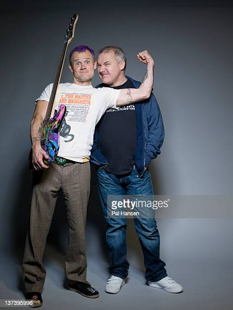 Artist Damien Hirst and guitarist with Red Hot Chili Peppers Flea are photographed for the Times on November 8 2011 in London England
