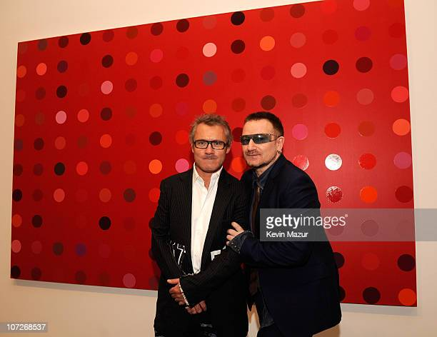 Artist Damien Hirst and Musician Bono attend The Auction to benefit AIDS in Aftica cocktail party at the Gagosian Gallery on February 13 2008 in New...