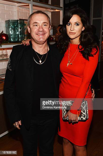 Artist Damien Hirst and Roxie Nafousi attend the Aby Rosen Samantha Boardman dinner at The Dutch on December 6 2012 in Miami Florida