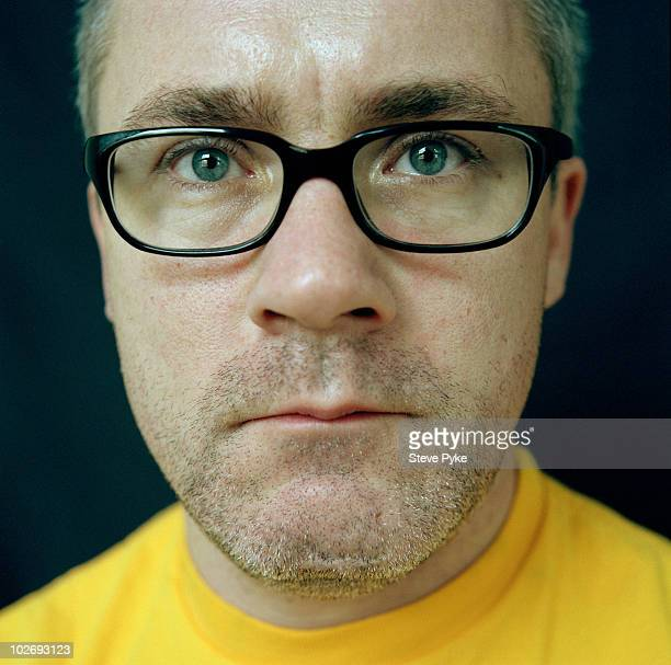 Artist Damien Hirst poses for a portrait shoot in London UK