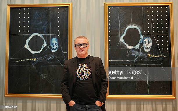 Artist Damien Hirst stands in The Wallace Collection at his 'No Love Lost Blue Paintings by Damien Hirst' exhibition on October 13 2009 in London The...
