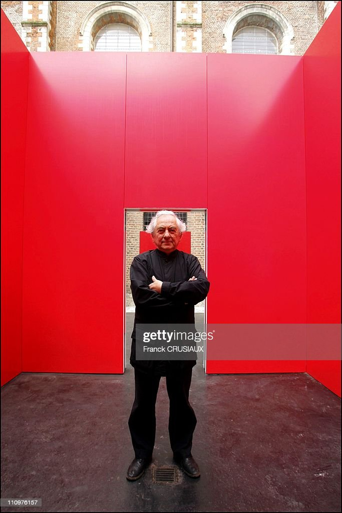 """Artist Daniel Buren and his """"Cabane rouge aux miroirs """" bought in the city of Douai for its Chartreuse Museum in Douai, France on May 31st, 2006. : News Photo"""