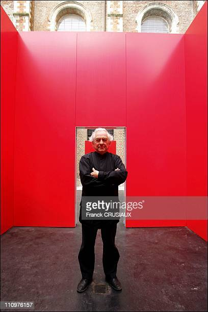 Artist Daniel Buren and his Cabane rouge aux miroirs bought by the city of Douai for its Musee de la Chartreuse in Douai France on May 31st 2006