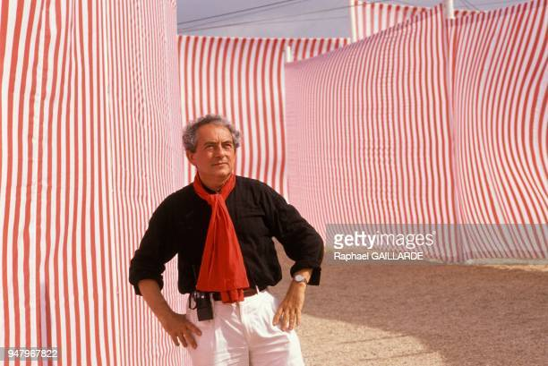 Artist Daniel Buren in front of one of his work with typical stripes in September 1989 in Valmy France