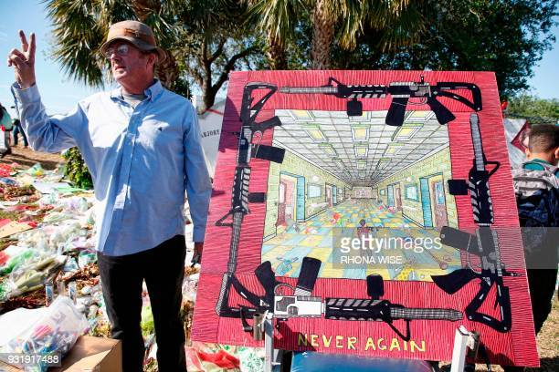 TOPSHOT Artist Daniel Linehan talks about his drawing in front of Marjory Stoneman Douglas High School as staff teachers and students walk out of...