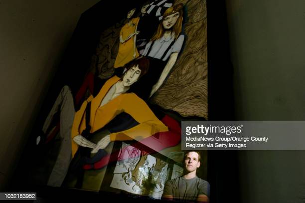 Artist Danny Roberts is reflected in one of his larger pieces in his parents Laguna Niguel home. ///ADDITIONAL INFO: fashion.danny.01xx.kjs --- Photo...
