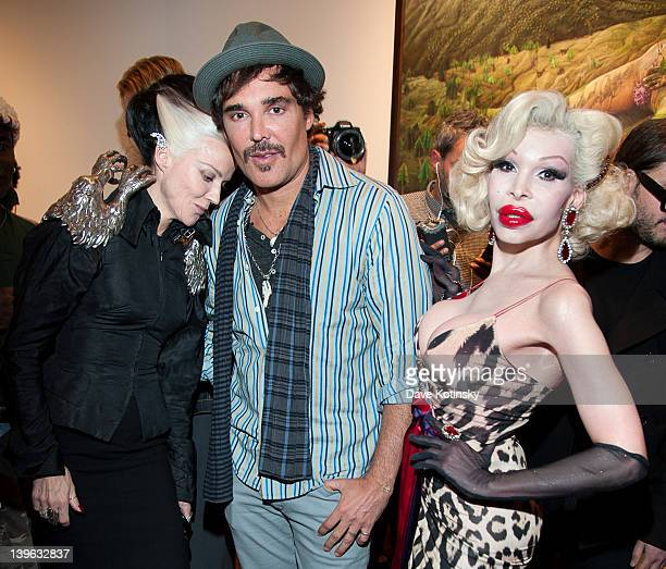 Artist Daphne Guinness photographer David LaChapelle and Amanda Lepore attend the David LaChapelle 'Earth Laughs In Flowers' exhibition opening at...