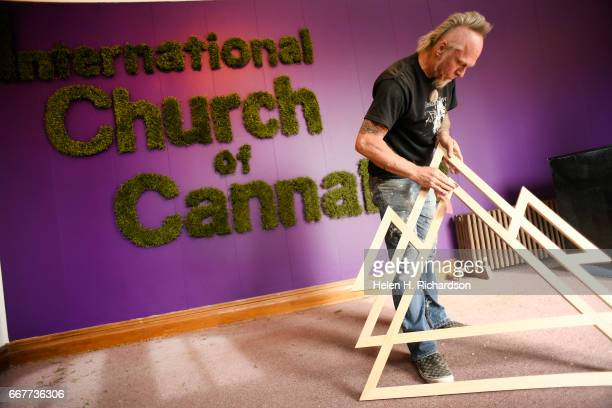 Artist Dave Bogue sands the new Elevationists' new logo or what church members have called it an eleglyph for the International Church of Cannabis at...