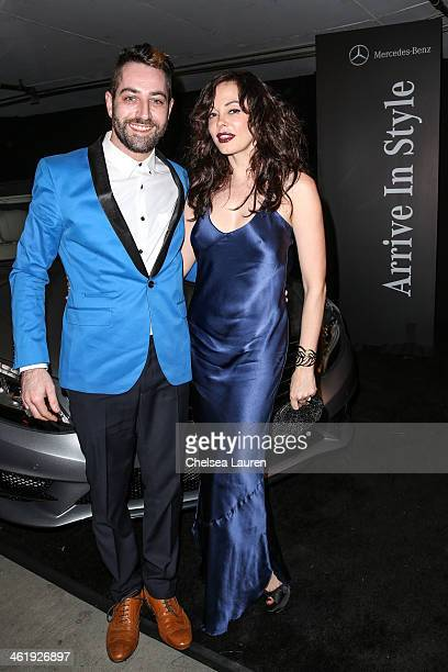 Artist Davey Detail and actress Rose McGowan arrive during MercedesBenz arrivals at The Art of Elysium's 7th annual HEAVEN gala on January 11 2014 in...
