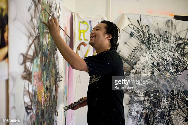Artist David Choe, who painted murals at the headquarters of Facebook in exchange for an undisclosed shares of company stock, is photographed in his...