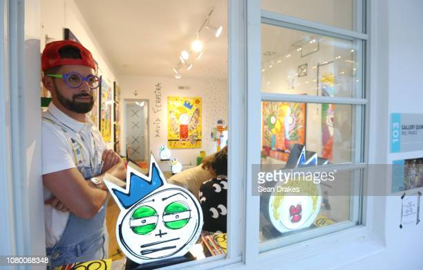 Artist David Ferreira poses with his artwork presented by Gallery Quinze at Aqua Art Fair as part of the 2018 Art Basel Miami Beach on December 8...