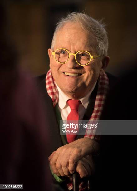 Artist David Hockney poses in front of The Queen's Window a new stained glass window at Westminster Abbey he designed and which was created by Barley...
