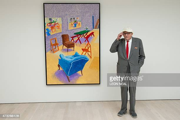Artist David Hockney poses with his painting 'Studio Interior 20142015' at a press preview of his new exhibition entitled 'Painting and Photography'...