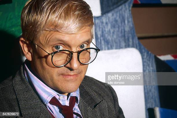 Artist David Hockney stands in the Theatre du Chatelet in Paris with the sets he designed for the plays Parade by Erik Satie and Les Mamelles de...