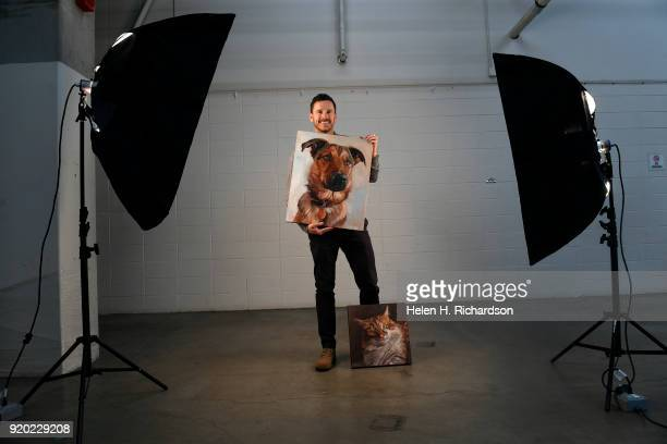 Artist David Kennett shows off some of his artwork during the Colorado Kennel Club Dog Show at the National Western Complex on February 18 2018 in...