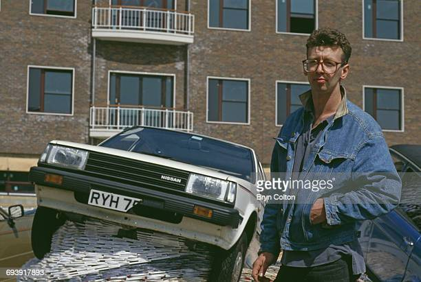 Artist David Mack poses for a photograph next to his art installation titled 'MultiStorey Car Park' on display at the BBC Television Centre in Wood...