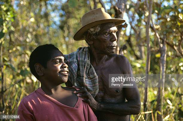 Artist David Malangi teaching his grandson Daniel how to hunt for goose eggs in his mother's country near Yathalamarra Central Arnhem Land 'This is...