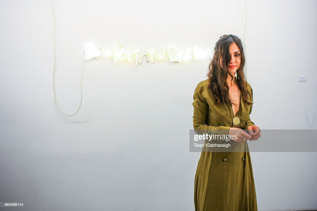 Artist Diana Garcia poses for a photo in front of her artwork at OptiMystic: A Brandon Boyd Pop Up Gallery Featuring He, Tasya Van Ree, Natalie Bergman, Diana Garcia And DJ Set By Brent Bolthouse at 101/Exhibit Gallery on December 1, 2017 in West Hollywood, California.