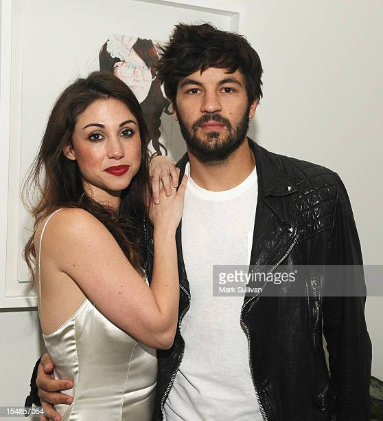 Artist Diane MarshallGreen and actor Jordan Masterson during the opening reception for Diane MarshallGreen's Lolitas at America Martin Gallery on...