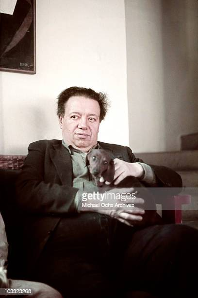 Artist Diego Rivera poses for a portrait at the home and studio she shares with his wife Frida Kahlo designed by architect Juan O'Gorman circa 1940...