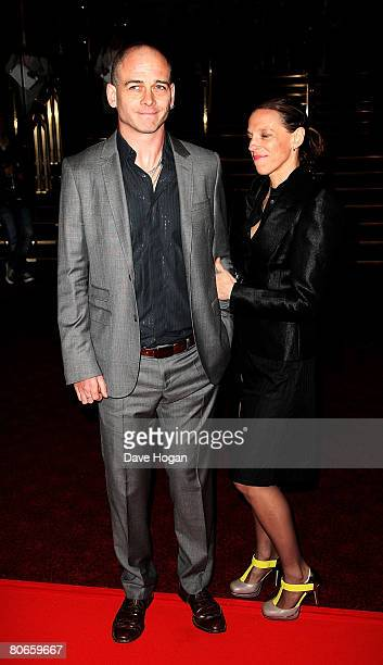Artist Dinos Chapman and his guest arrive at the UK premiere of 'Flashbacks of a Fool' at the Empire cinema Leicester Square on April 13 2008 in...