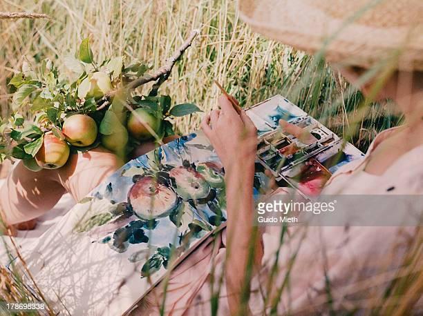 Artist doing a watercolour outdoor