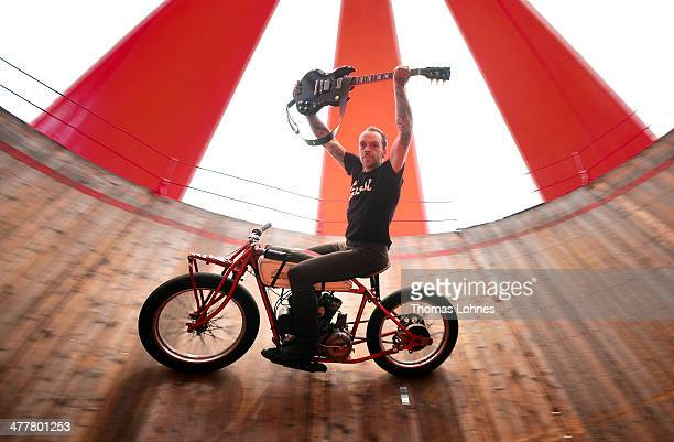 Artist Donald Ganslmeier performs with a Gibson SG Standard MinETune in a daring show on vintage motorcycles in the original motodrome of 1928...