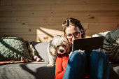 Artist Drawing At Home In Company Of Her Poodle Dog