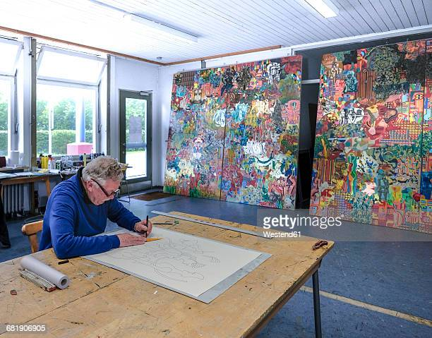 Artist drawing in his studio