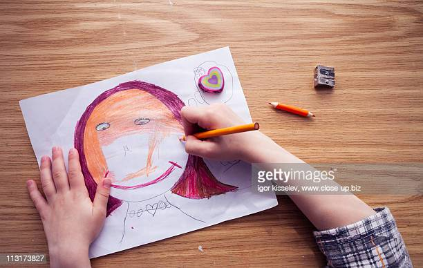 artist drawing woman face - colouring stock photos and pictures