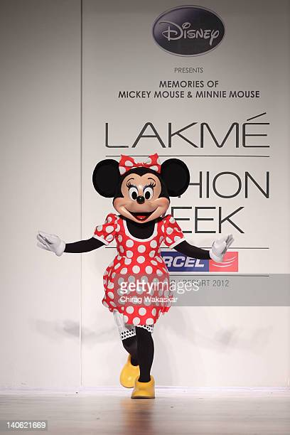 Artist dressed as Minnie Mouse walks the runway at the Disney Couture show at Lakme Fashion Week Summer/Resort 2012 Day 2 at the Grand Hyatt on March...