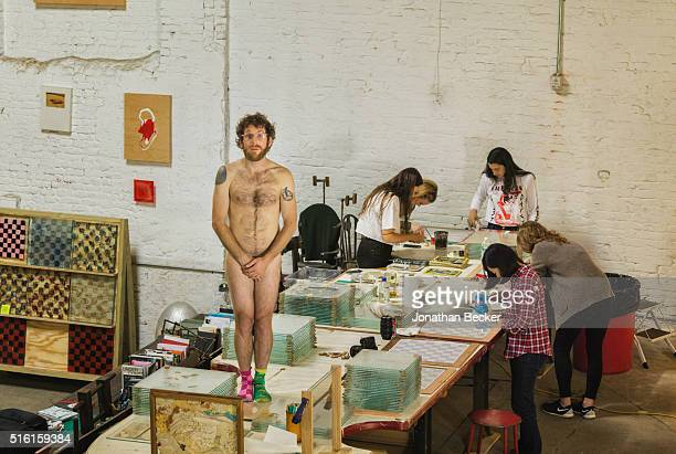 Artist Dustin Yellin is photographed with his assistants for Vanity Fair on June 3 2015 in his Red Hook studio in Brooklyn New York PUBLISHED IMAGE