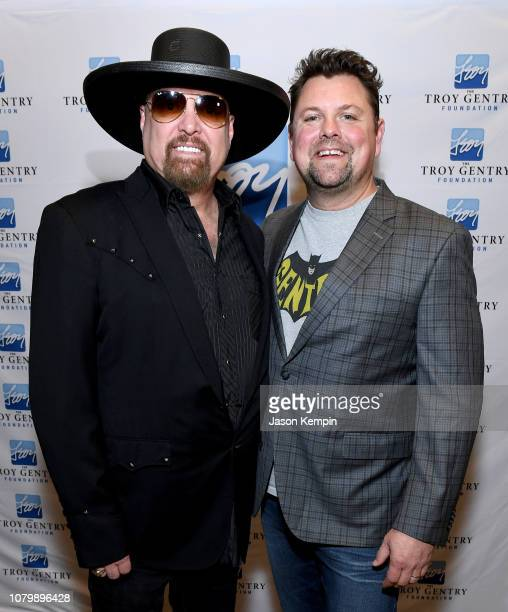 Artist Eddie Montgomery and radio personality Storme Warren attend C'Ya on The Flipside benefit concert benefitting The Troy Gentry Foundation at The...