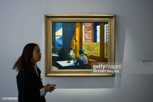 US artist Edward Hopper's 'Chop Suey' estimated in the region of 70 million USD is displayed during a media preview at the Christies showroom in Hong...
