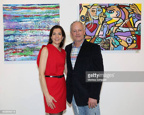 Artist Elizabeth Christopher and artist Scott Christopher pose with their work at 'love art give a smile' Art Fashion And Design Benefit at Clen...